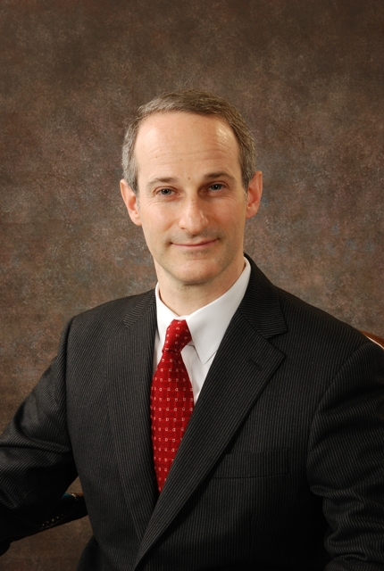 Dr. Adam Komisarof