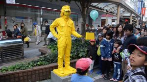 yellow man on street and crowd