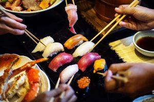 people sharing japanese food