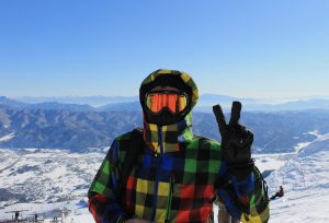 skier gives peace sign